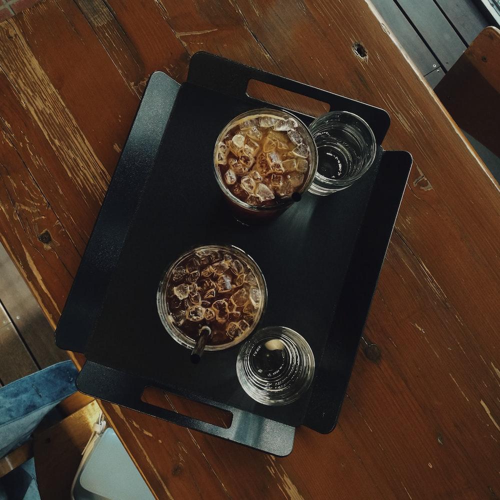 drinking glas on black tray