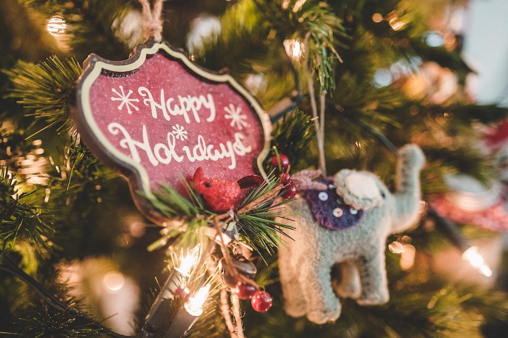 grey elephant Christmas ornament hang on lighted Christmas tree