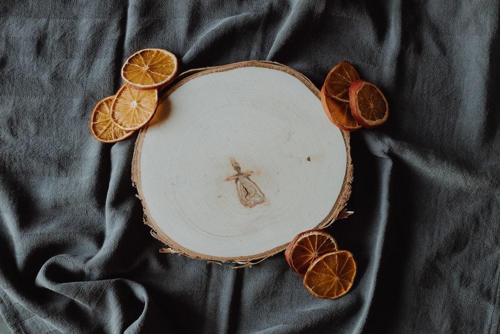 sliced citrus beside ceramic panel