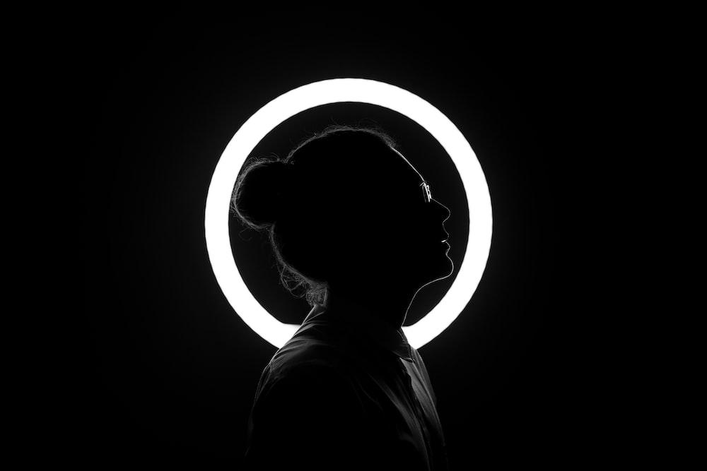 woman standing beside halo light