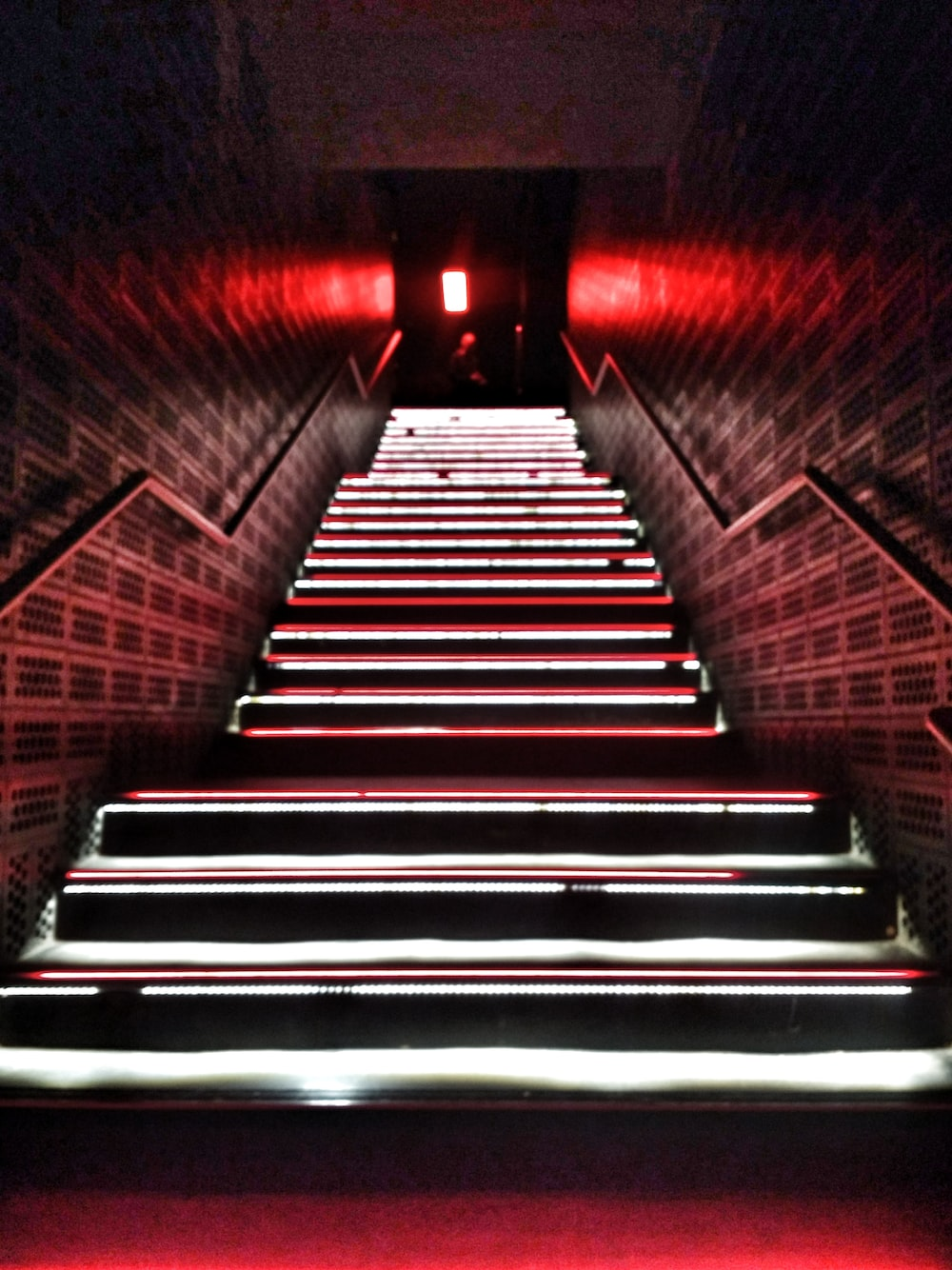 low-angle photography of a lighted narrow staircase
