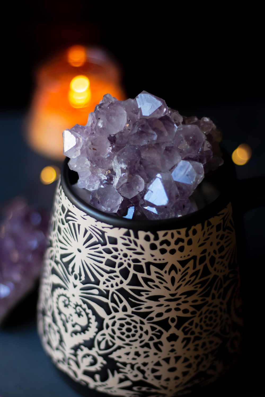 purple quartz on white and black floral container