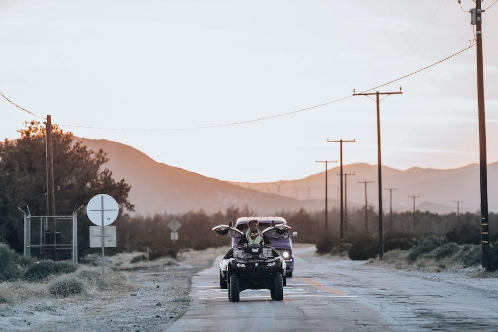 person riding ATV on road