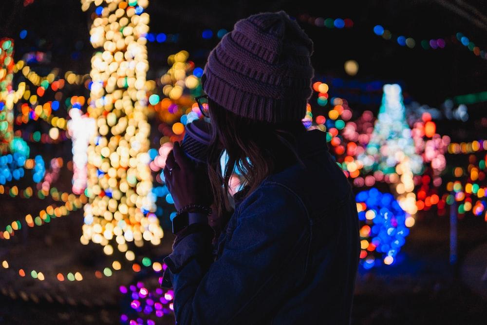 bokeh photography of woman near lights