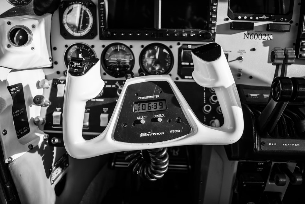 grayscale photo of aircraft controller