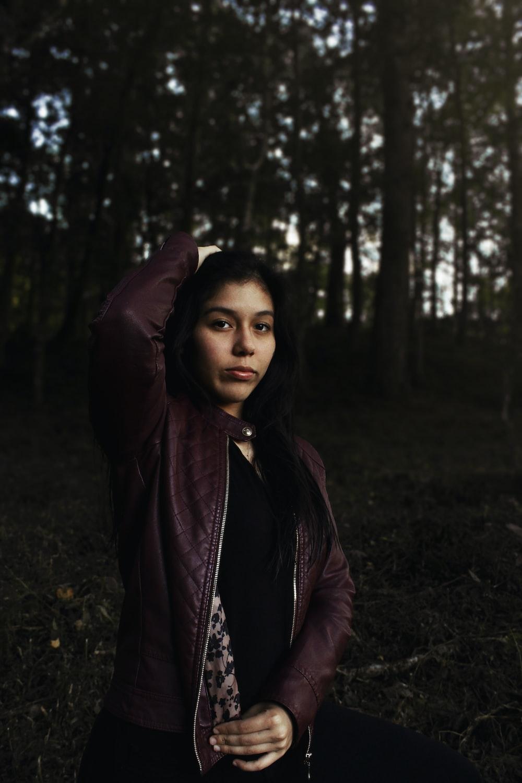 woman wearing maroon jacket