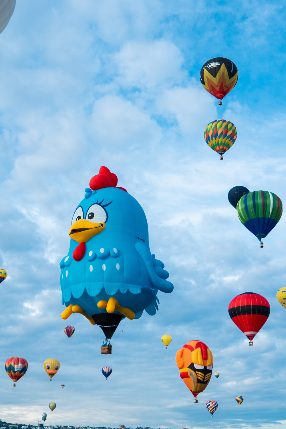 assorted-colored hot air balloons midair scenery