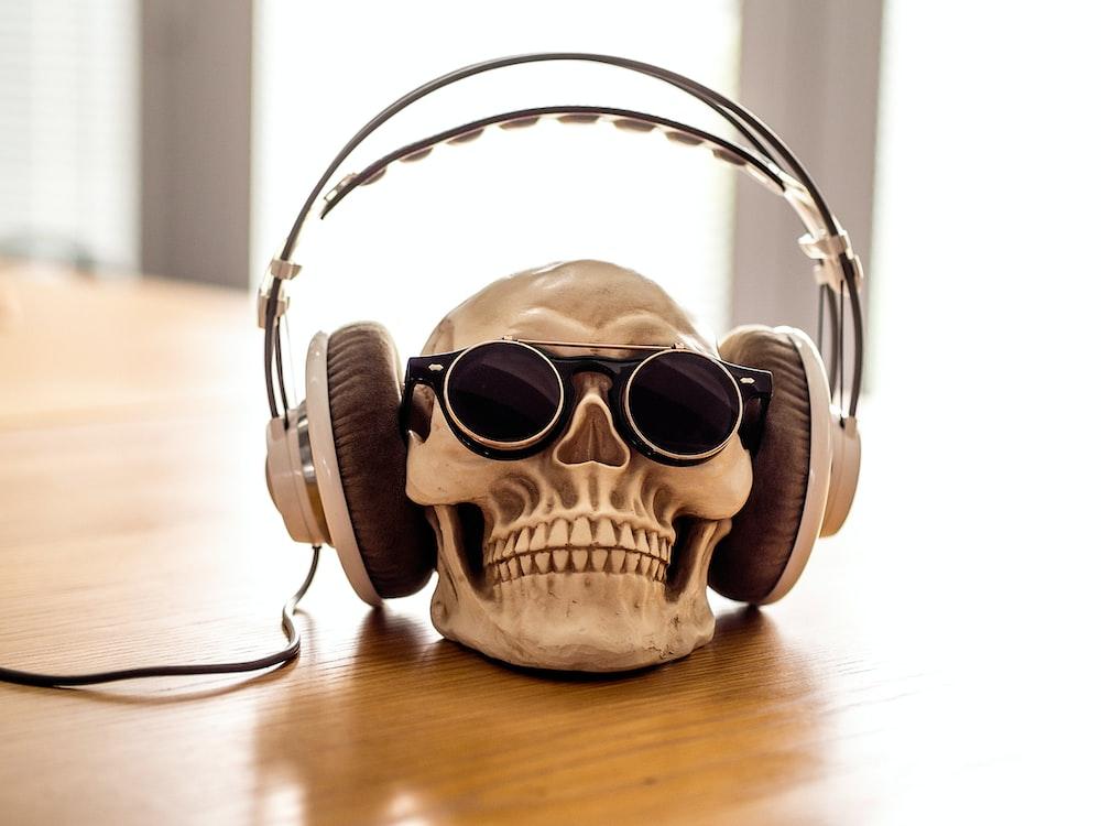 white headphones on skull decor