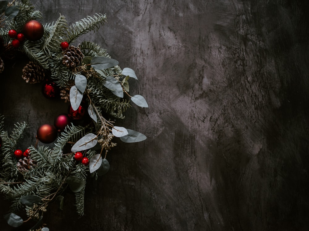 green Christmas wreath with red decors