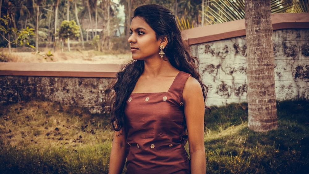 woman wearing brown dress