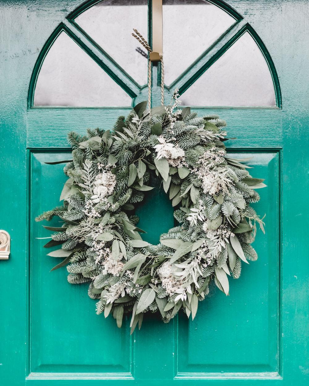green leafy wreath hanging on door