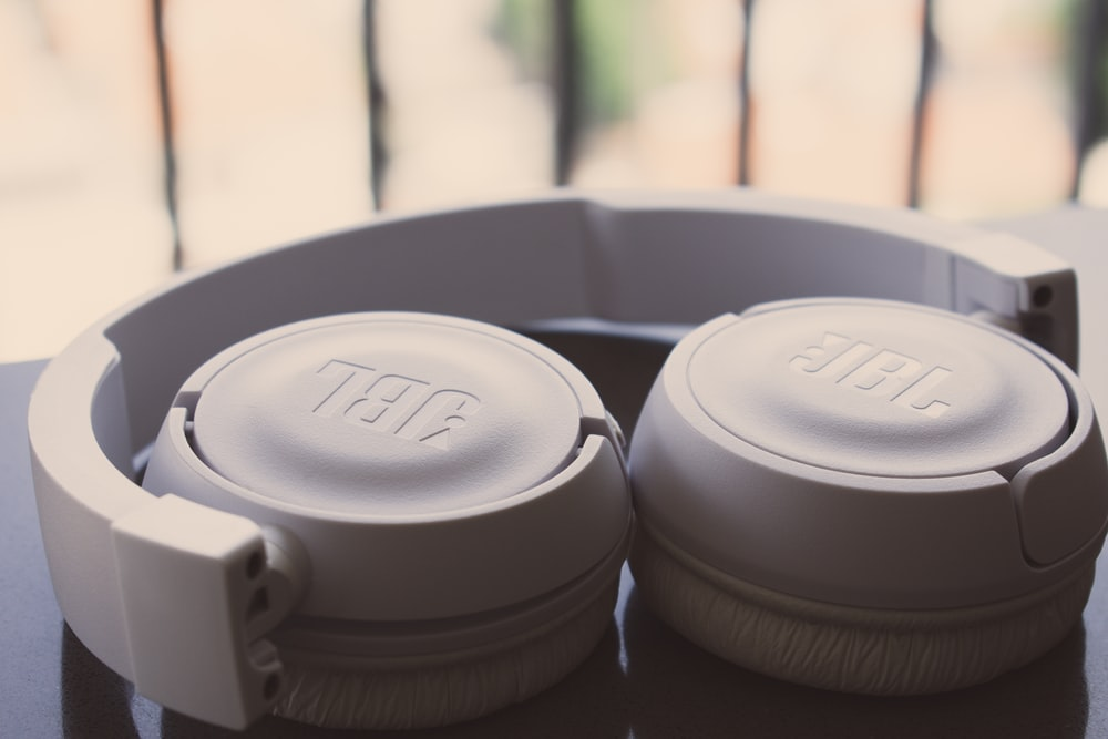 white JBL wireless headphones
