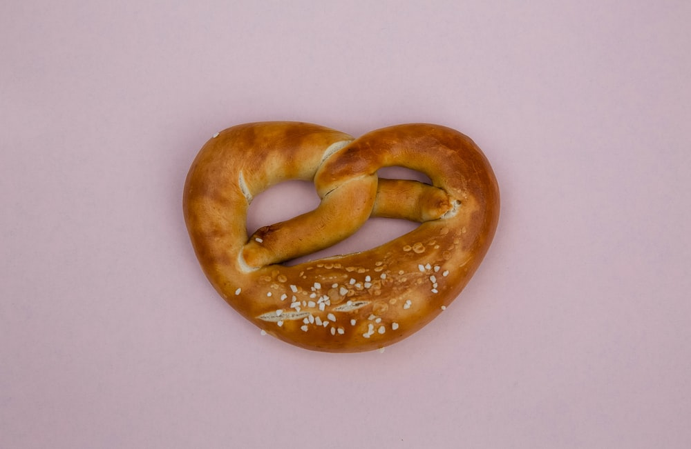 bread knot on pink surface
