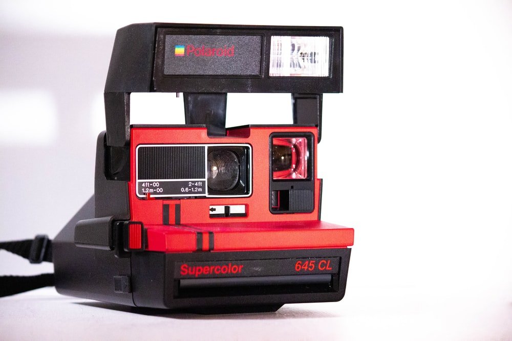 black and red Polaroid Supercolor 645 CL instant camera