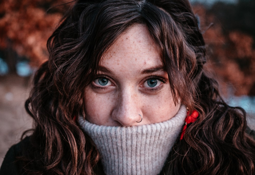 portrait photograph of woman in gray sweater
