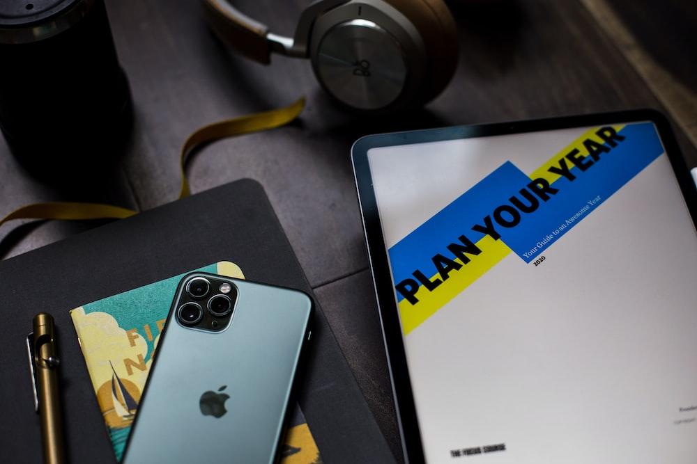 black iPhone 11 Pro Max near gold twist pen