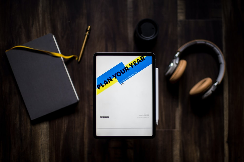 black tablet computer turned on displaying Plan Your Year application