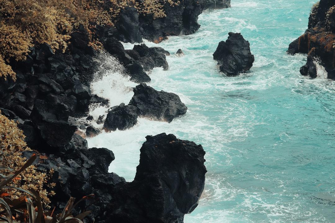water crashes on rocks