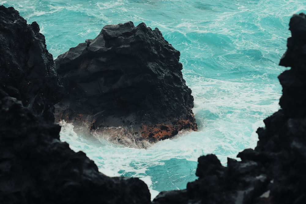 rock formations in body of water