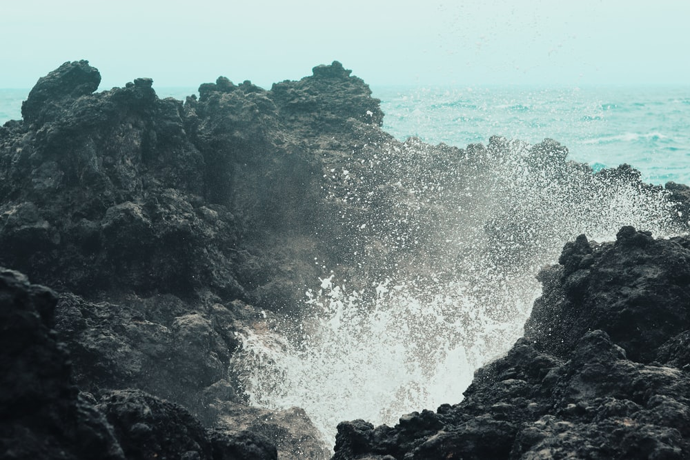 sea waves on gray rock formations