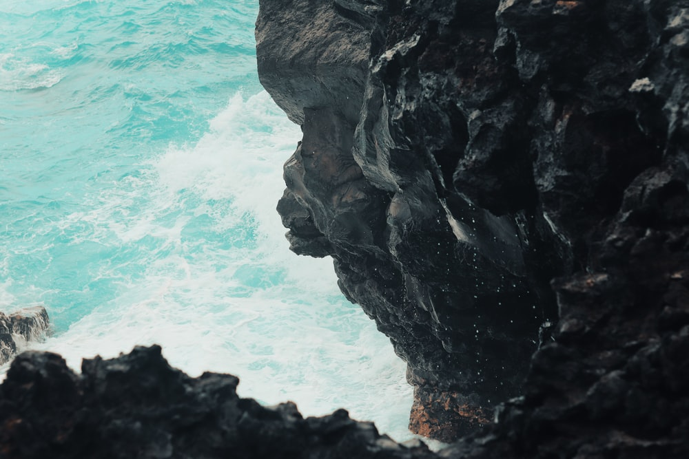 aerial photography of body of water and cliff