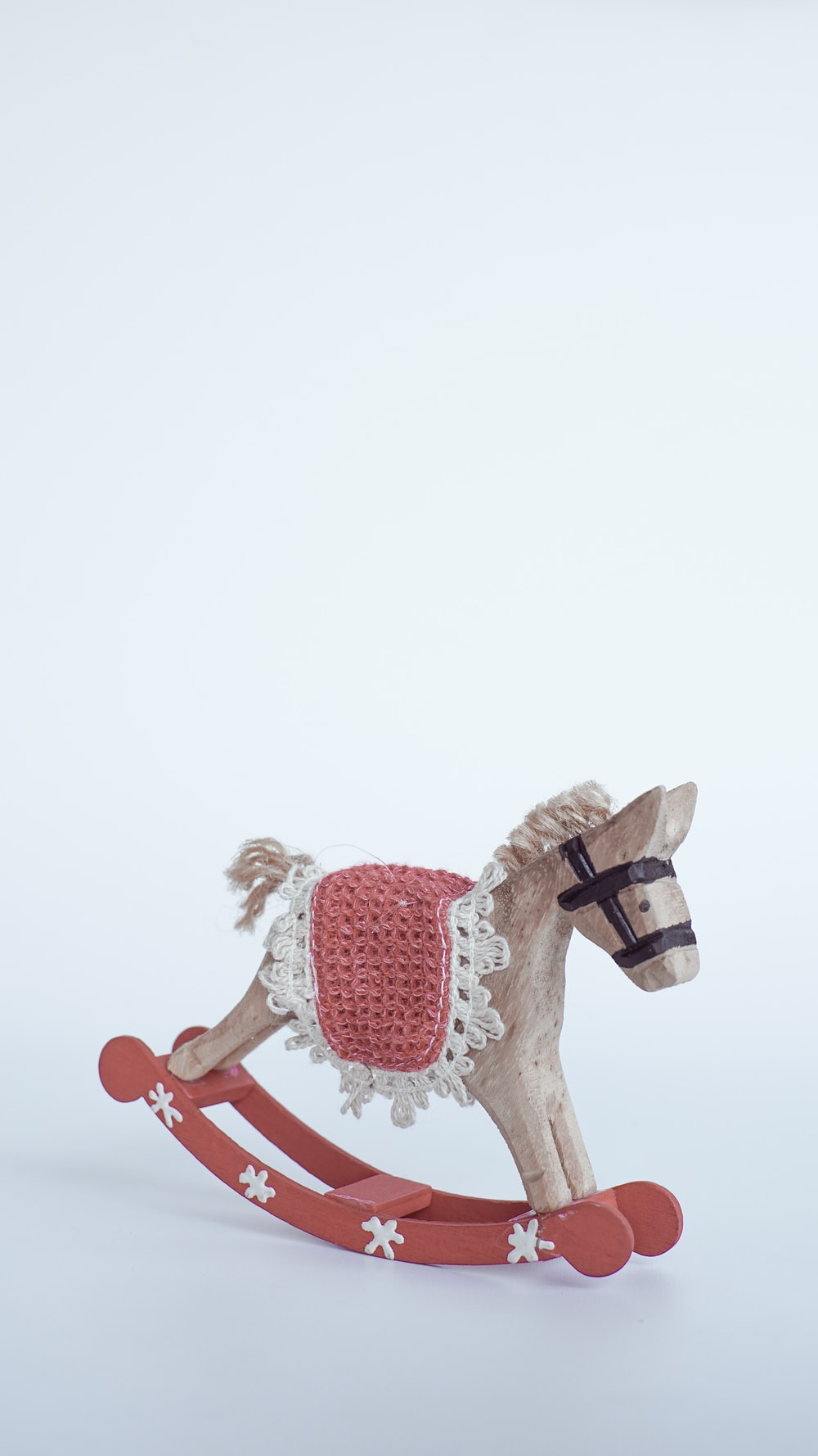 brown and red rocking horse toy