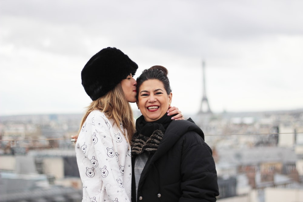 woman kissing woman on forehead