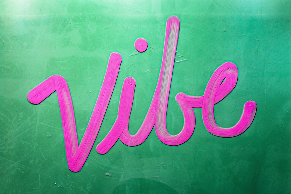 Vibe text on green surface