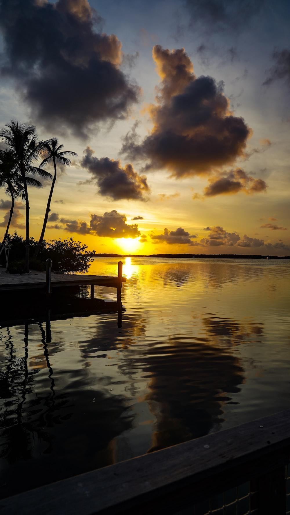calm body of water under golden hour