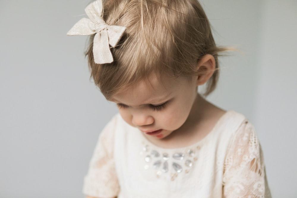 toddler in white top