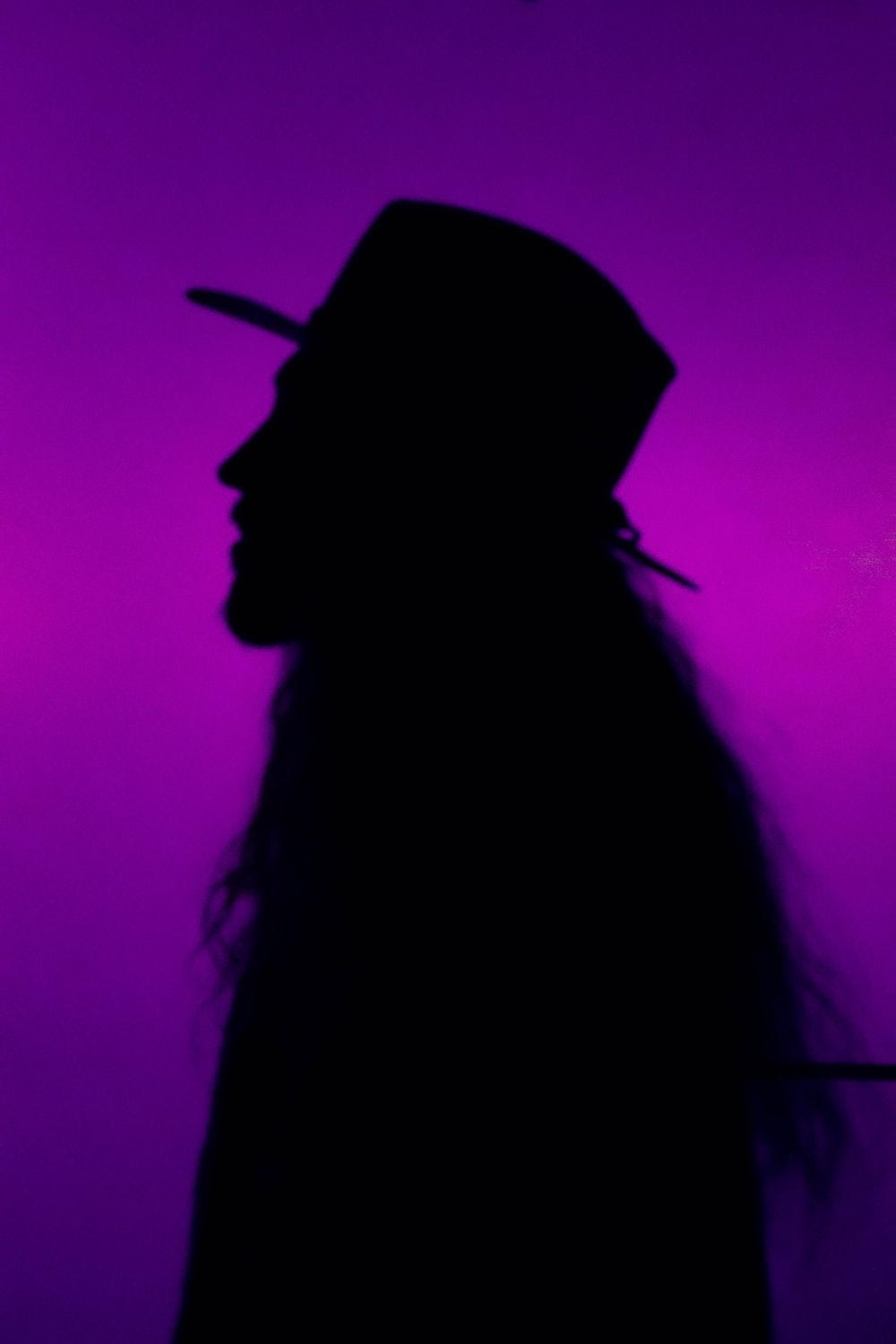 silhouette photography of person in hat