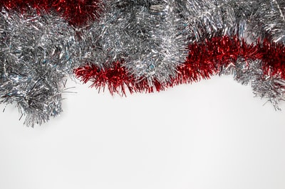 silver and red garlands tinsel teams background