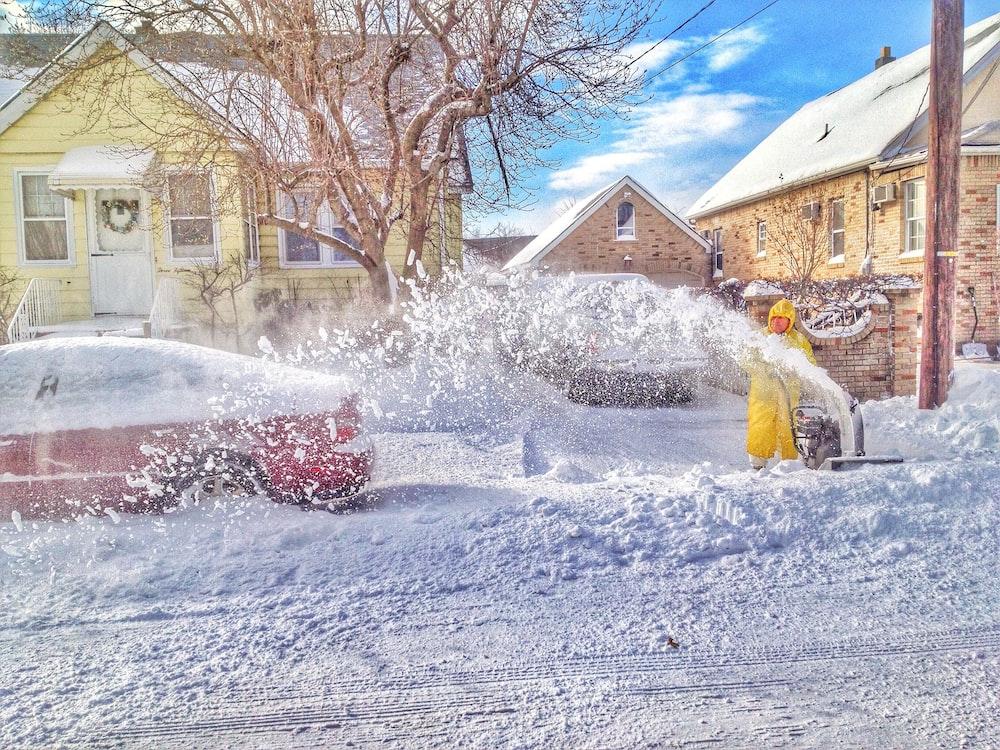 man using snow thrower