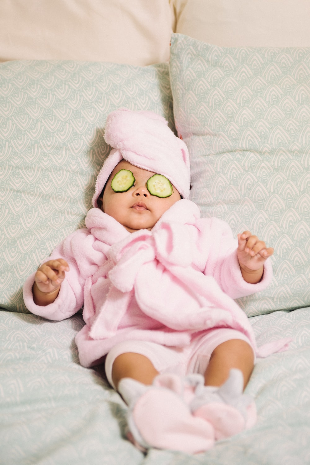 baby in pink bathrobe and towel