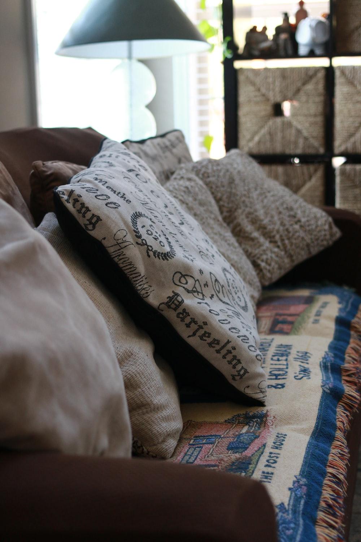 several white pillows on sofa