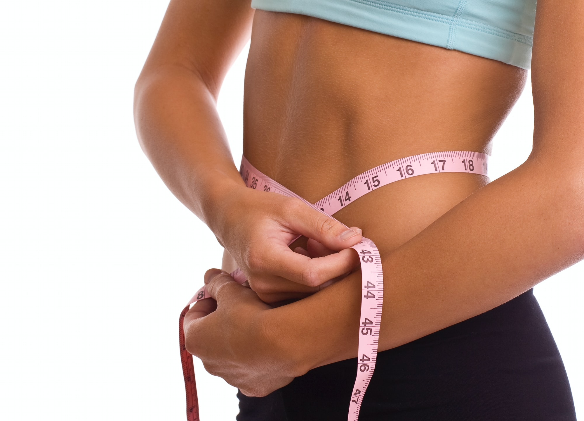 Woman measuring stomach with measuring tape. Concept for fitness and diet.