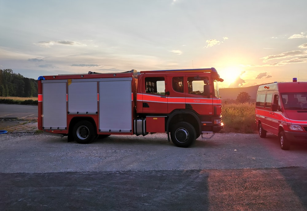 white and red crane truck