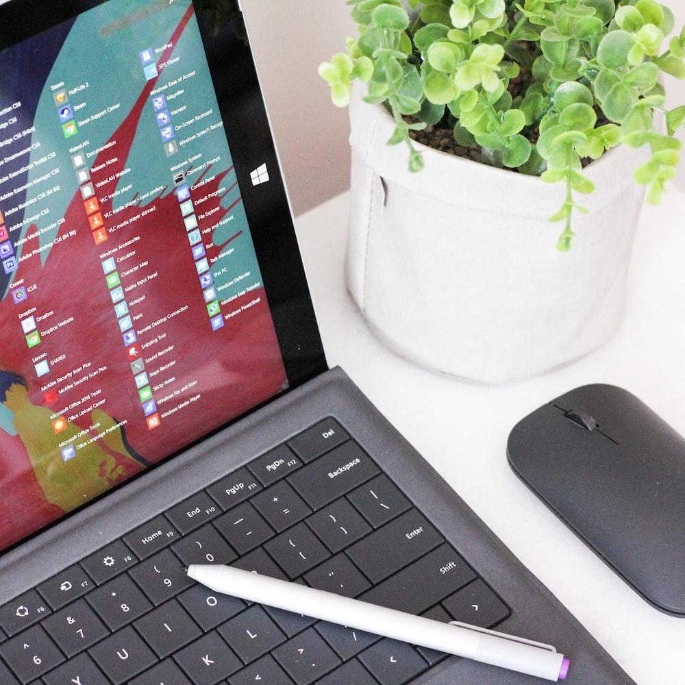 black laptop computer beside black wireless mouse