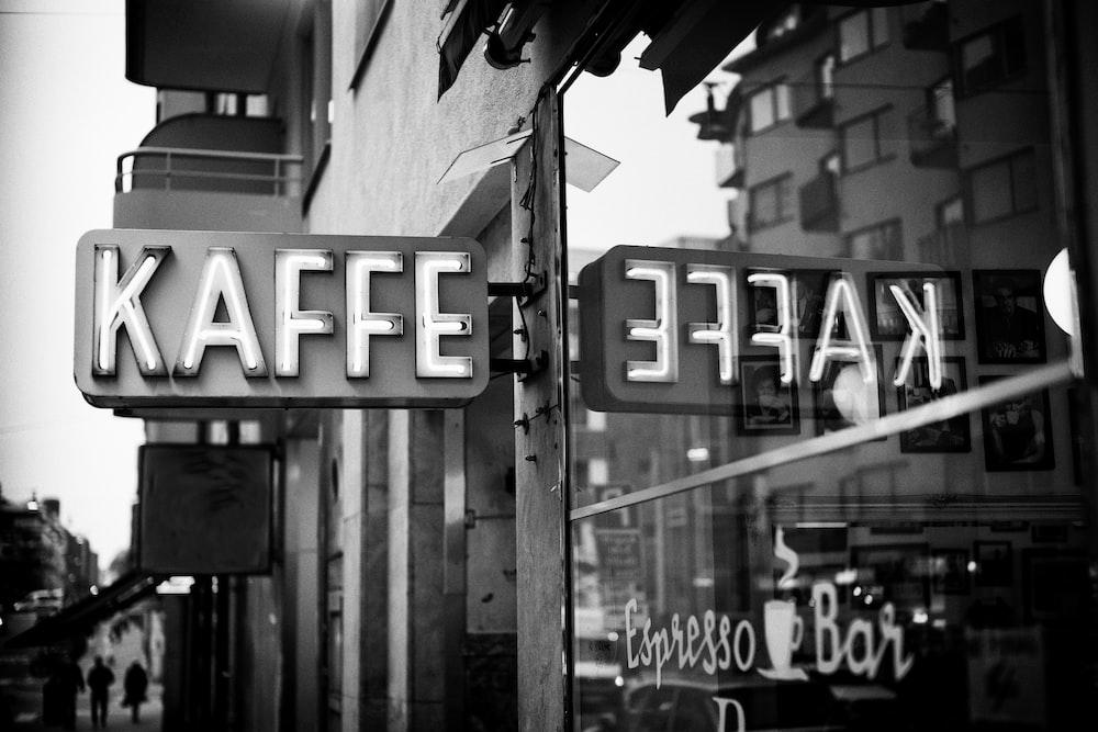 Kaffe bar in grayscale photo