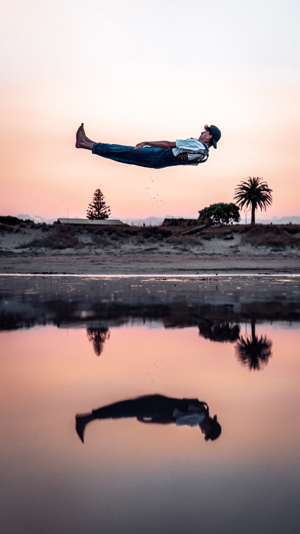 man above body of water during daytime