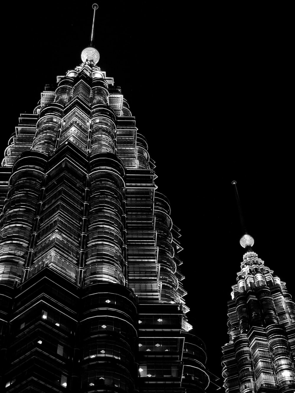 grayscale photography of Petronas Tower