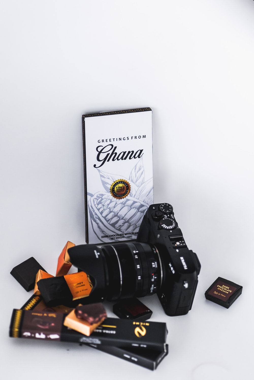 black DSLR camera near chocolate packets