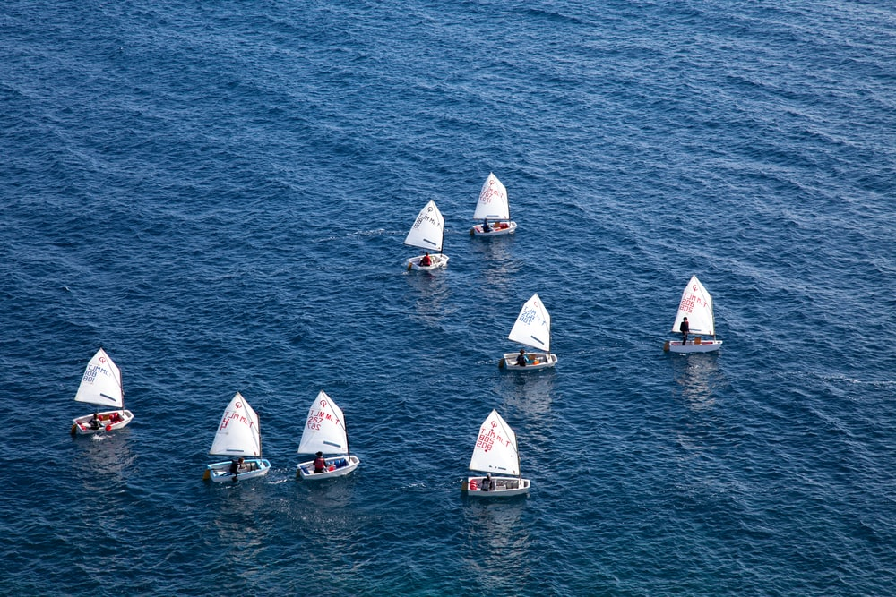 sailboats on body of water during day