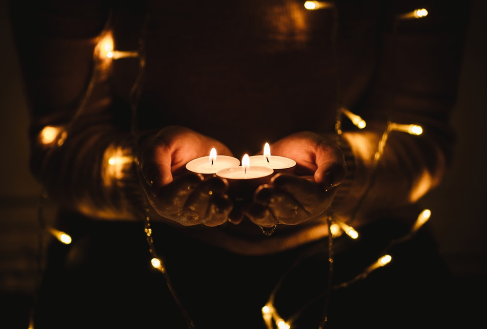 selective focus photography of three lit tealight candles