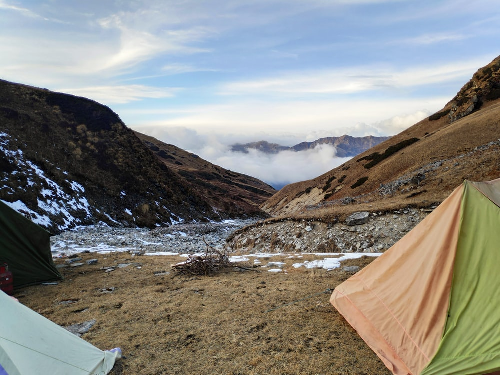 tents near mountain under white sky