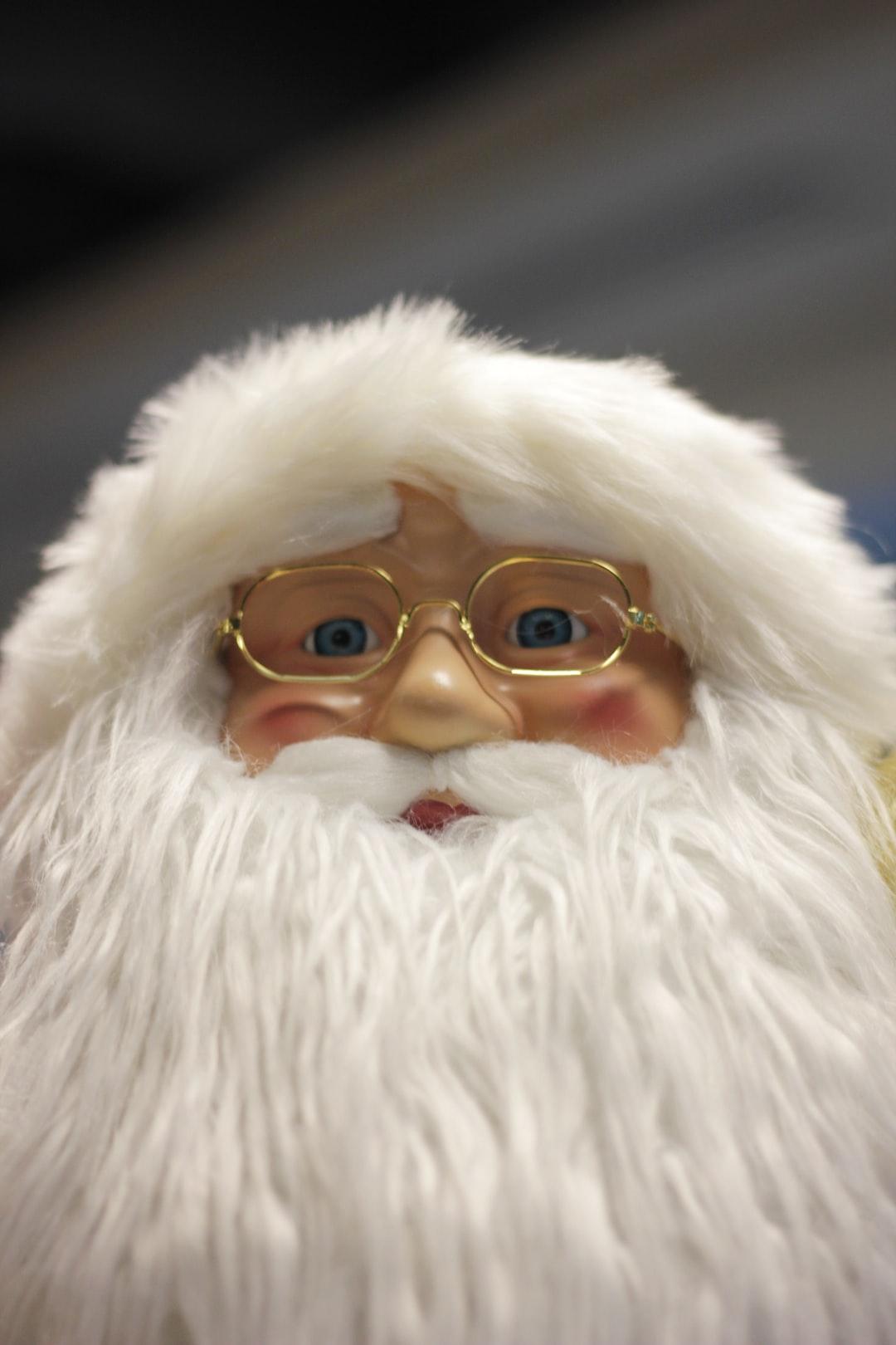 Santa is looking at you behind his eyeglasses.