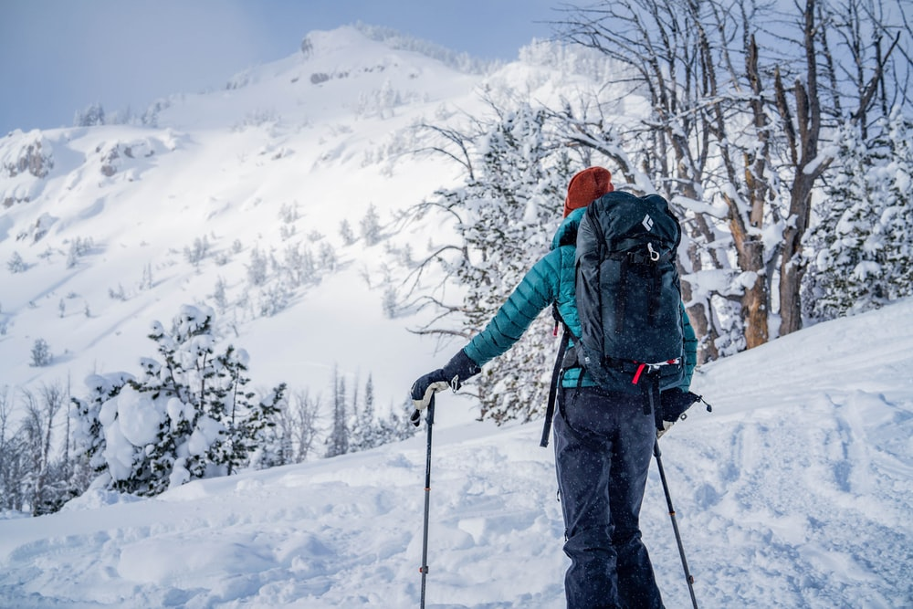 man skiing in a snowy mountain