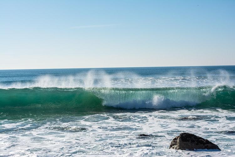 A wave crashing on the coast