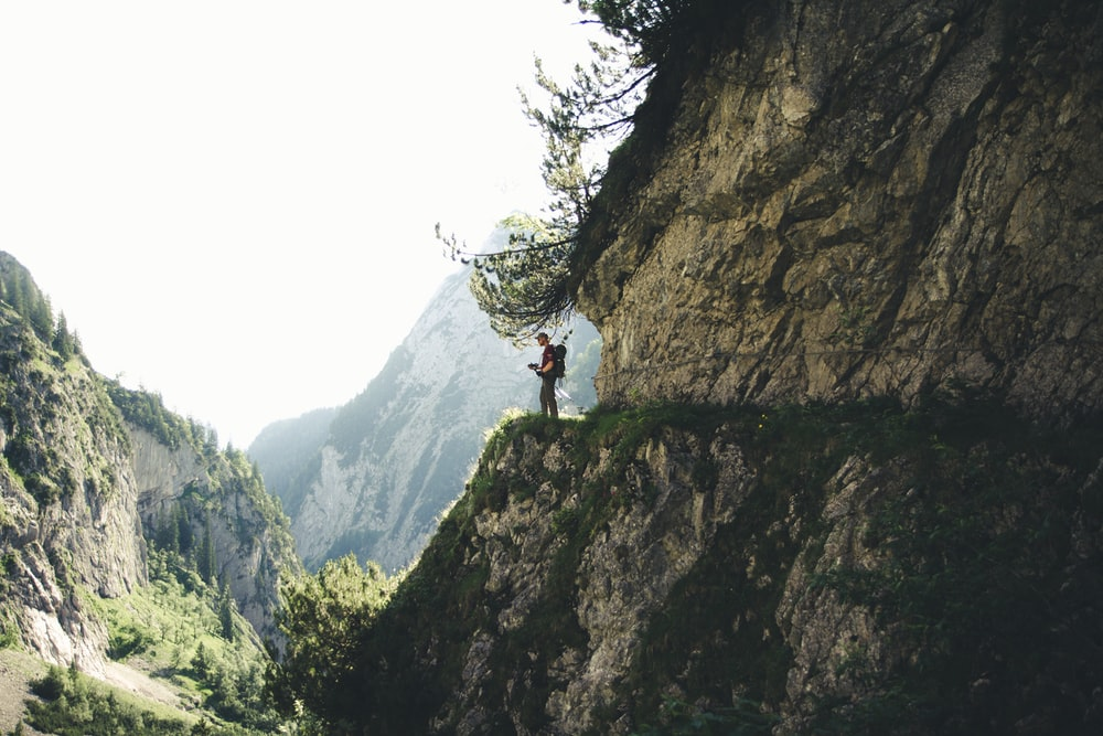 man stands at the cliff