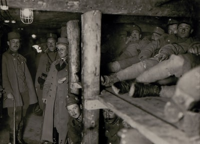 grayscale photography of soldier men inside cave troops teams background